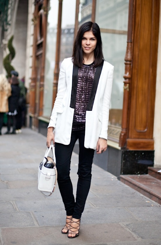 WHITE-TUXEDO-JACKET-VIA-A-LOVE-IS-BLIND-STREET-STYLE-FASHION-WEEK-EMILY-WEISS-INTO-THE-GLOSS-PURPLE-SEQUIN-SHIMMER-TOP-BLACK-PANTS-WHITE-BAG-REPOSSI-RING-ALAIA-HEELS-STRAPPY
